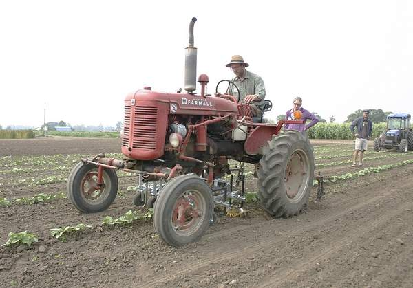 John Yeo, cultivation manager and agronomist for Gathering Together Farm in Philomath, Ore., demonstrated mechanical equipment purchased earlier this summer during the first mechanical cultivation field day at Oregon State University.
